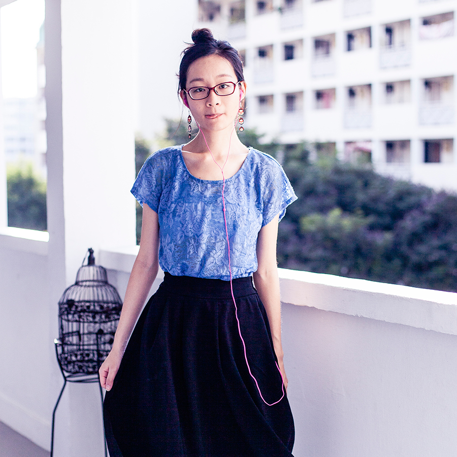 Forever 21 blue lace top, Lowry's Farm black midi skirt with pockets, Dresslink house print crew socks, Matryoshka earrings.