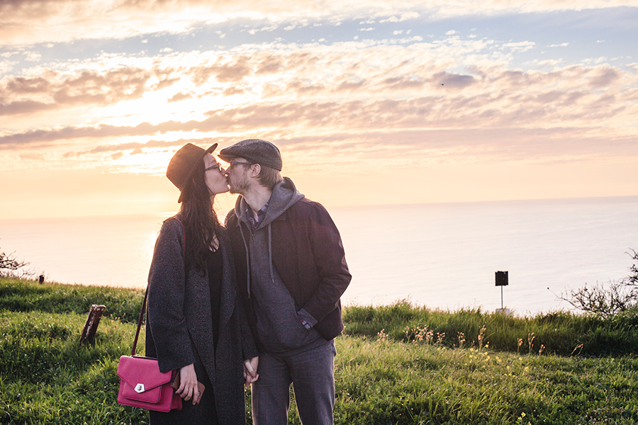 Ren & Ottie sharing a kiss against the sunset atop Signal Hill, Cape Town. Photo taken by Cand.