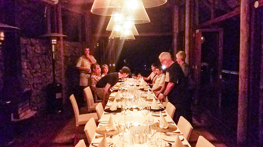 Dining together for dinner indoors at Rhino Post Safari Lodge, Kruger National Park, South Africa.