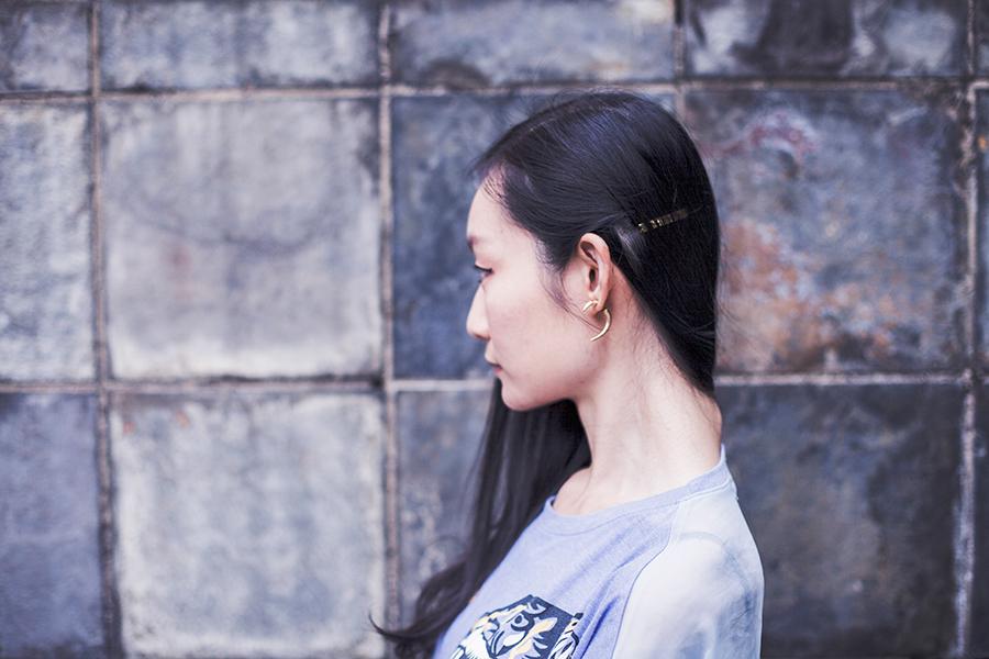Gold horn earrings, gold hair barrette.
