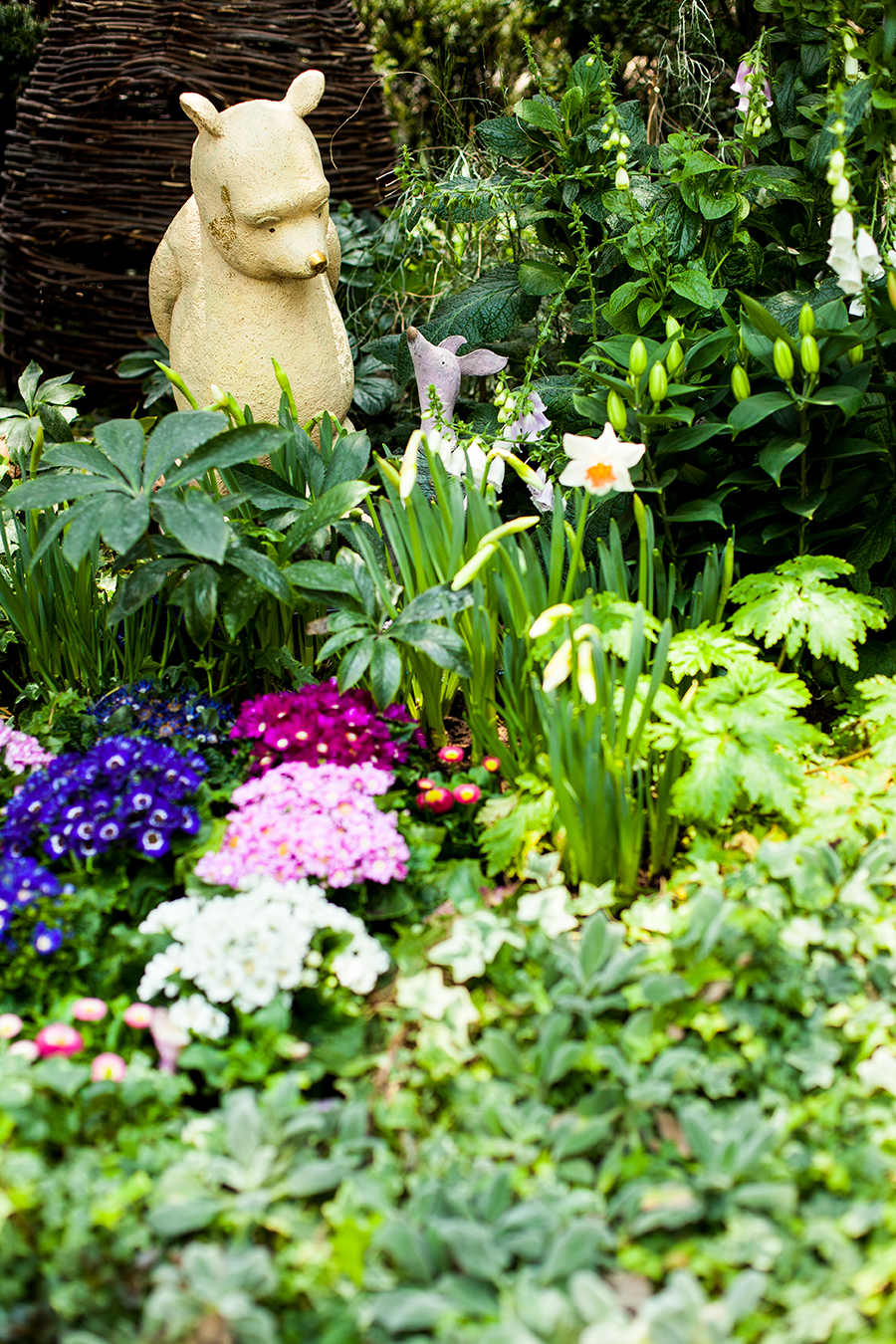 Winnie the Pooh and Piglet among flowers at the Flower Dome at Gardens by the Bay, Singapore.