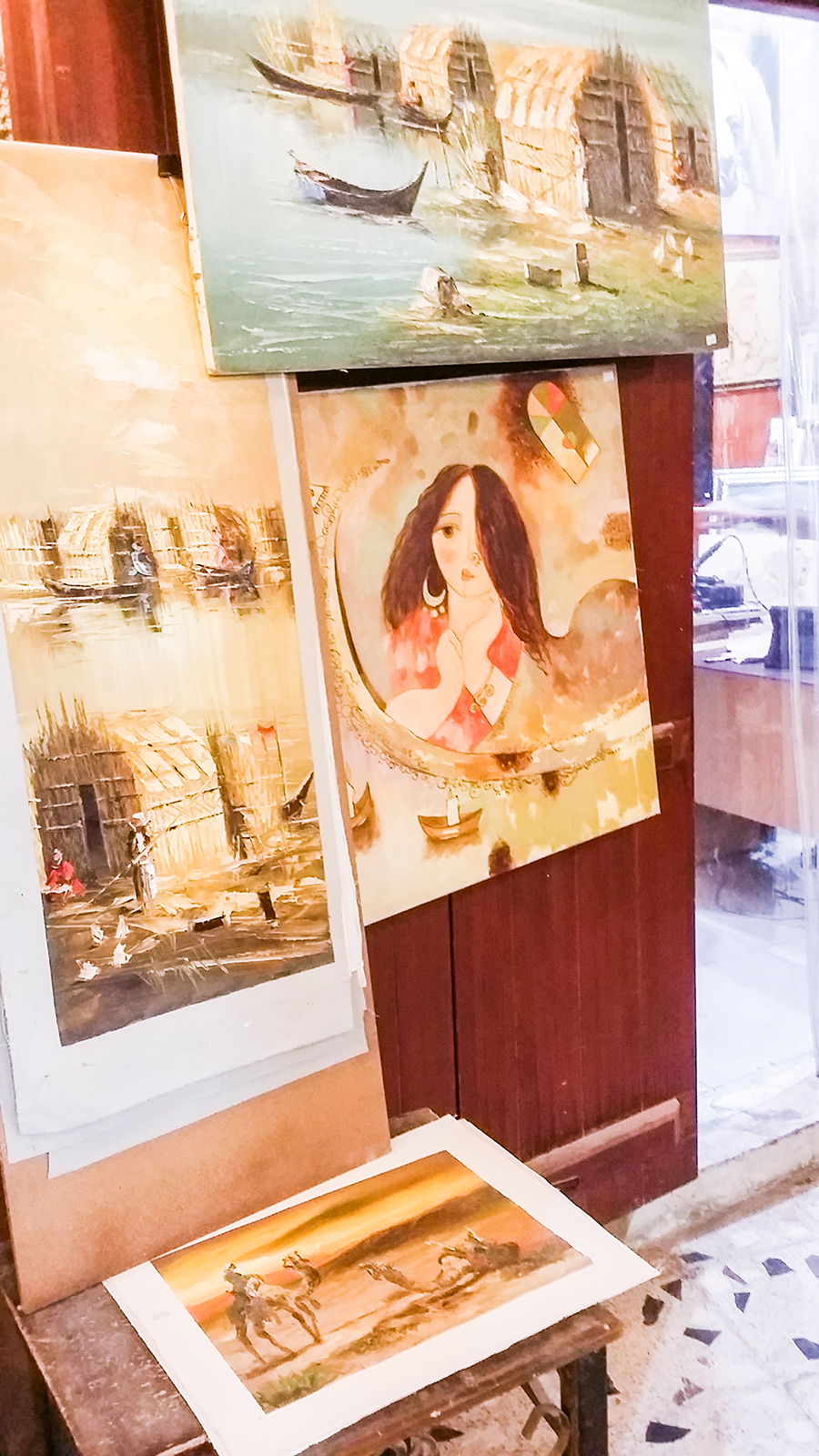 Paintings on sale at Souq Waqif (سوق واقف), Doha, Qatar.