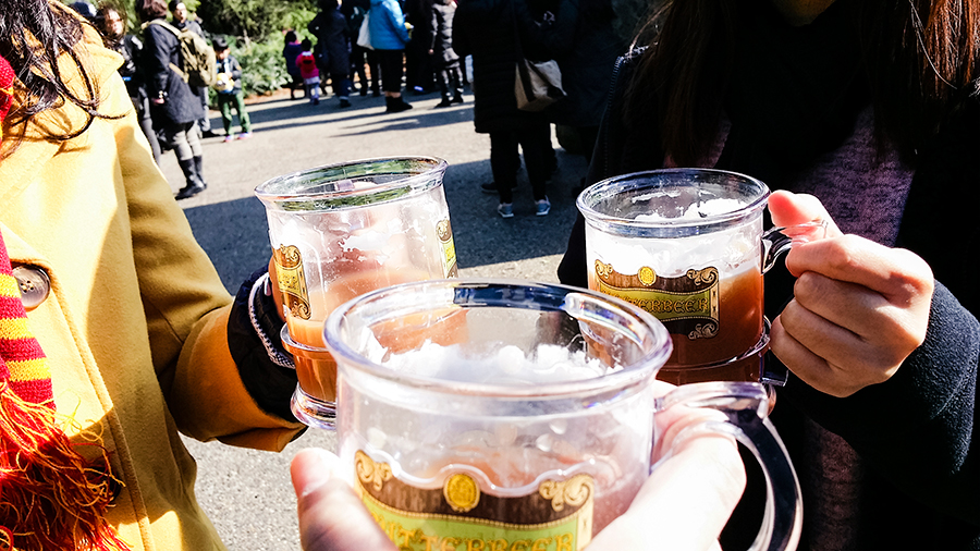 Clinking our Butterbeer at the entrance of The Wizarding World of Harry Potter at Universal Studios Japan, Osaka.
