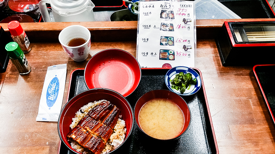 Unagi don and menu at Takagi Suisan eel restaurant, Osaka, Japan.