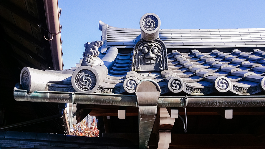 Face on a roof tile at Fushimi Inari, Kyoto Japan.