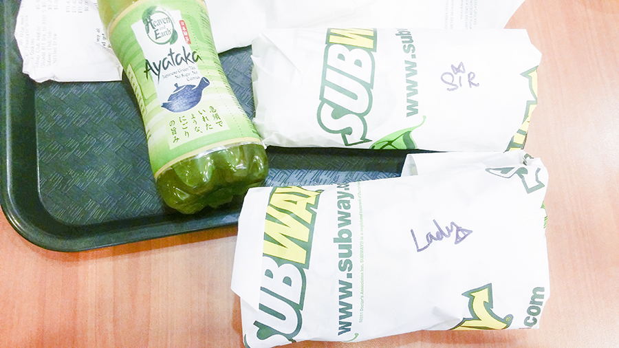 Subway sandwiches and Ayataka green tea bottle.