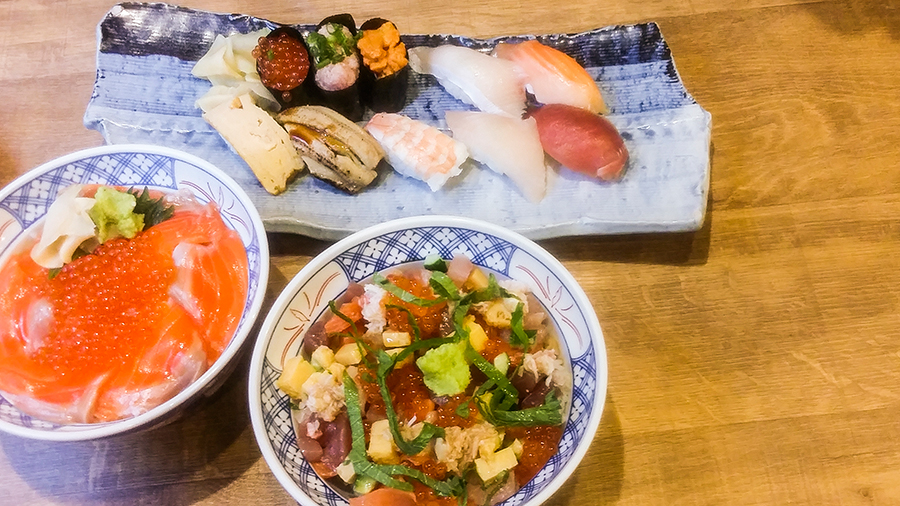 Sushi, Shake Oyako Don, and Chirashi Don at Isomaru Suisan in Tokyo, Japan.