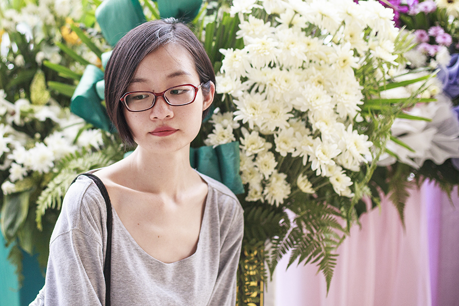 Portrait among flowers.