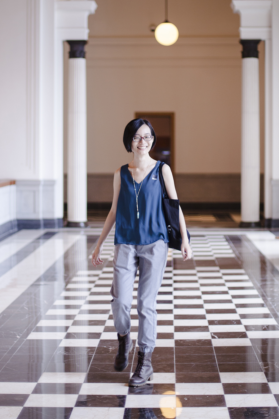 National Gallery Singapore: walking on checkered floor.