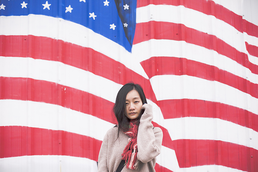 In front of the US flag: Fox multicolor scarf, boyfriend sweater.