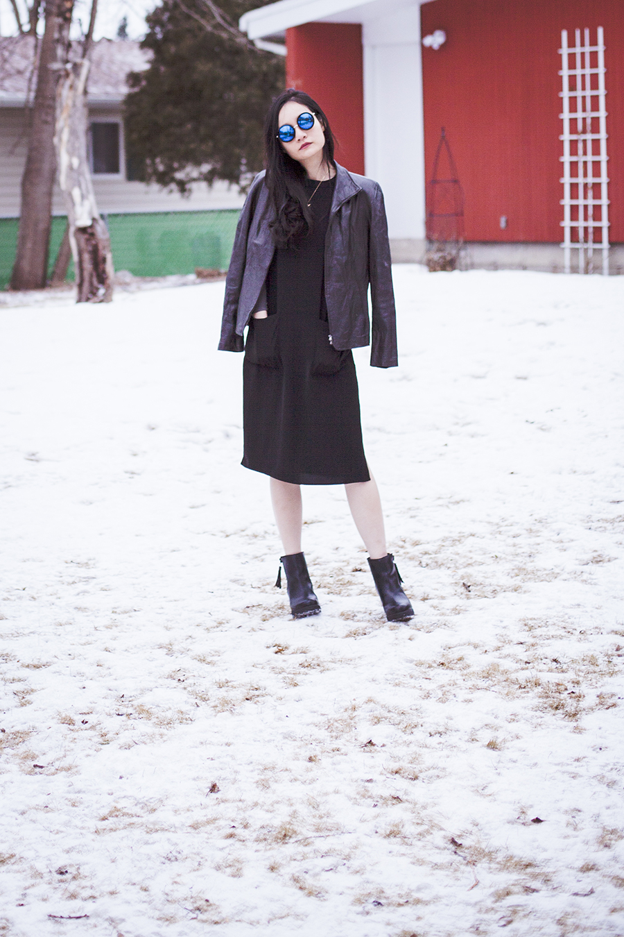 Monochrome winter outfit: P.Rossa black leather jacket, Forever 21 black dress, DealSale amethyst necklace, Uniqlo Heattech top, Steve Madden black tassel heel boots, CNDirect blue sunglasses.