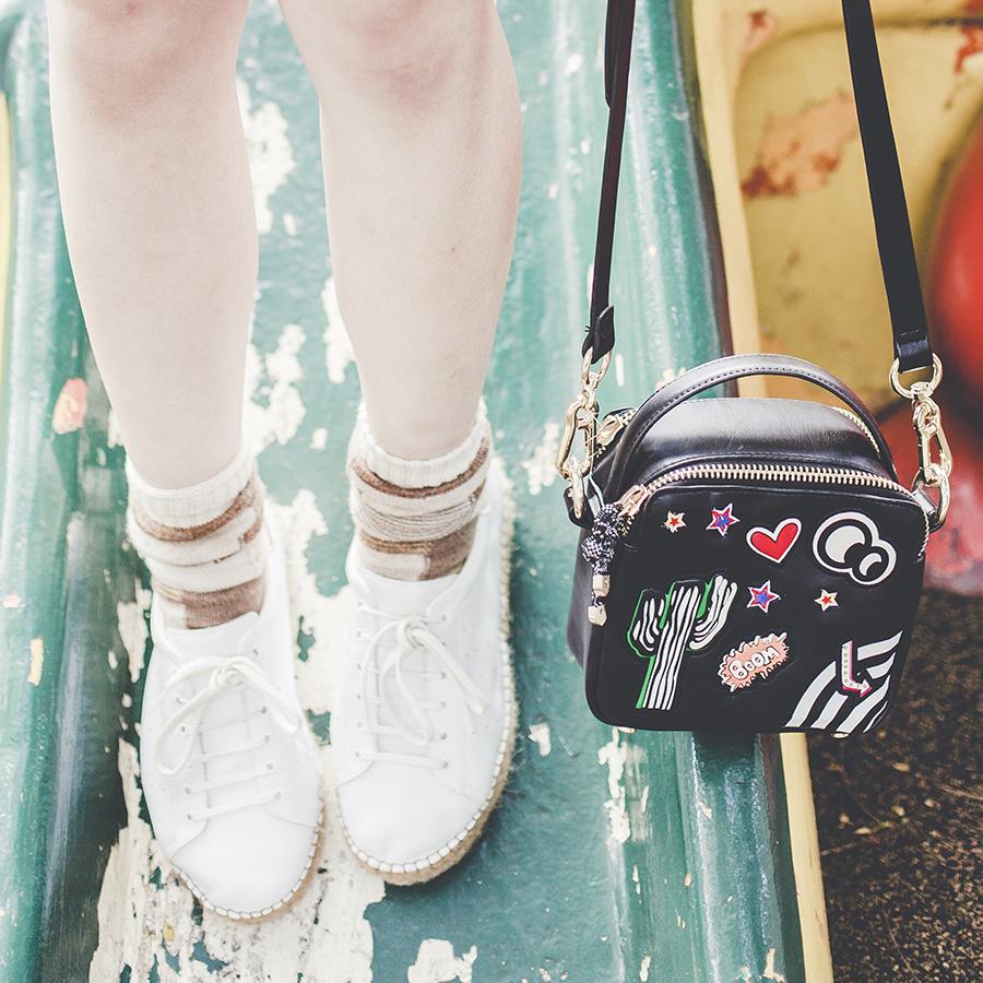 Zara patch bag, Anonymous Ism patchwork socks, Kurt Geiger lovebug sneakers.
