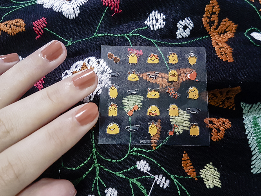 Gudetama nail stickers from Holika Holika on OPI nail varnish.