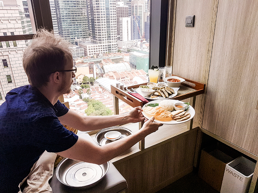 Behind-the-scenes Instagram Husband holding our room service dine-in lunch at hotel PARKROYAL on Pickering, Singapore.