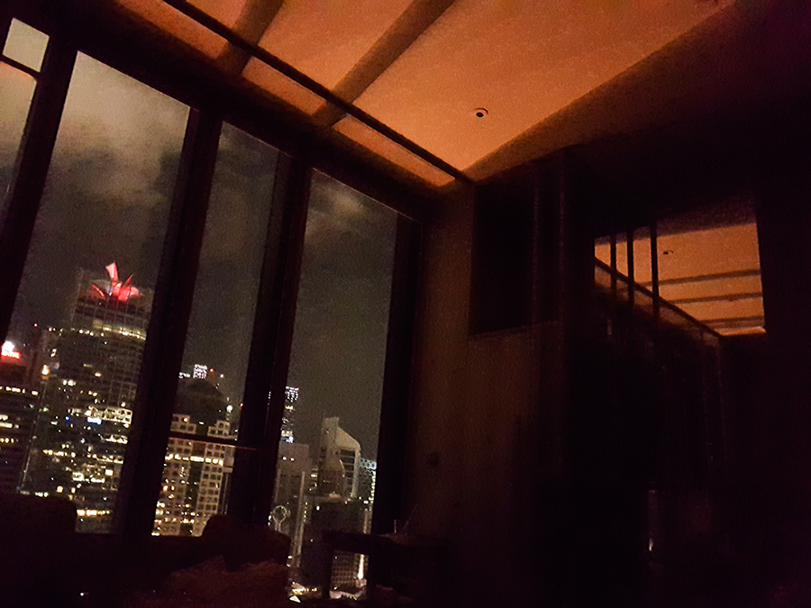 Night view of downtown from our Orchid Club Double Room at hotel PARKROYAL on Pickering, Singapore. CapitaGreen flower light-up at night.