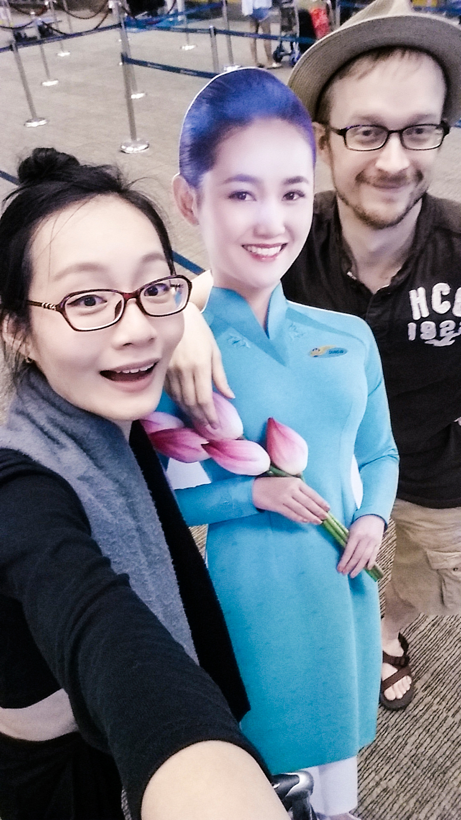 Selfie with a cardboard cutout from Vietnam Airlines at Singapore Changi Airport.