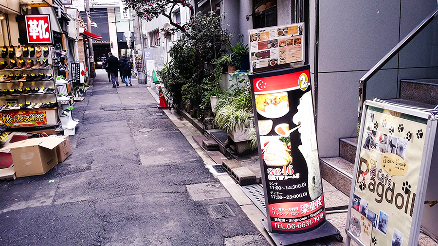 Singapore food signage in an alley in Osaka, Japan.