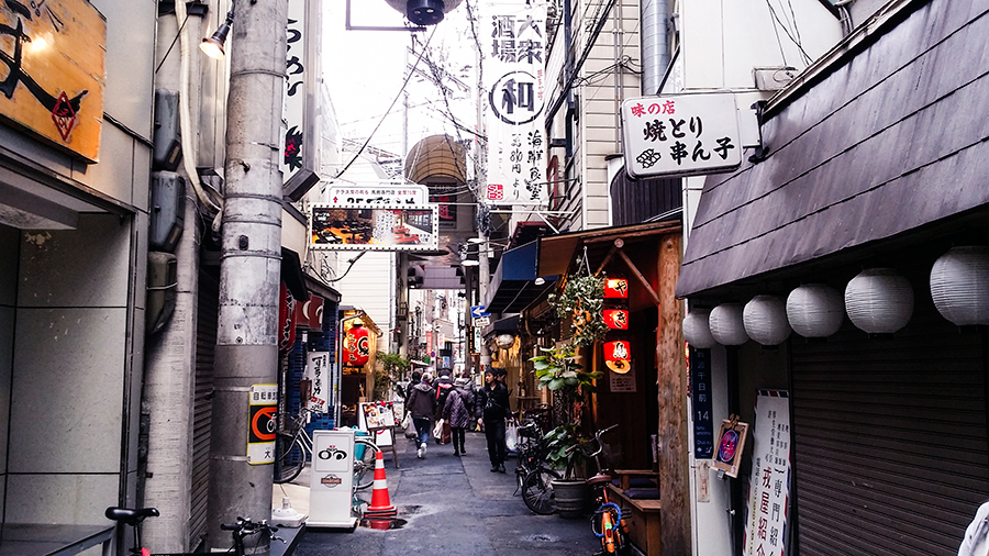 Alley filled with shophouses in Osaka, Japan.