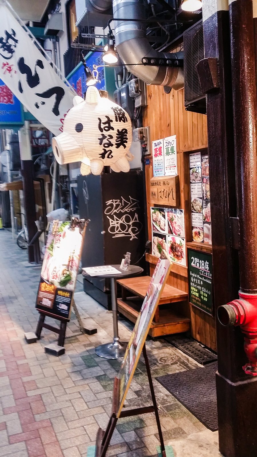 Pig chōchin lantern hanging outside a food restaurant in Osaka, Japan.