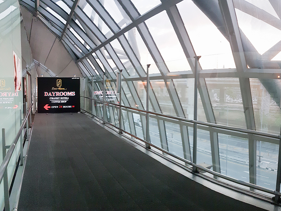 Louis' Tavern Day Room signage at Suvarnabhumi airport in Bangkok, Thailand.