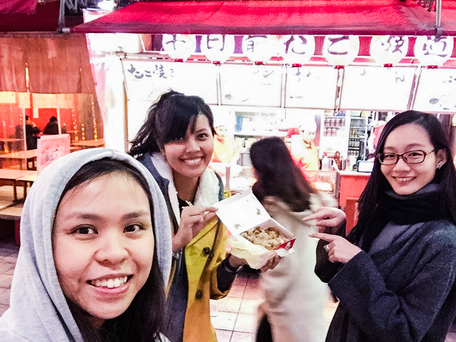 Posing with our Takoyaki outside the stall in Osaka, Japan. Photo by Ruru.