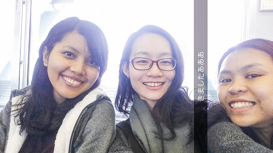 Photo of the three of us on a train in Osaka, Japan.