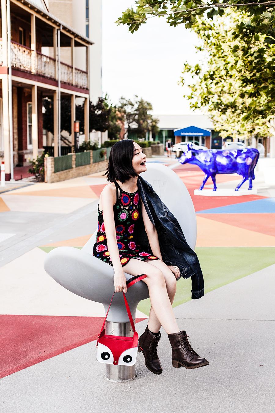 Crochet outfit: H&M Coachella inspired crochet dress, Matryoshka earrings, Blend denim jacket, fox bag, Steve Madden boots.