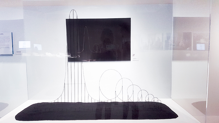 Scaled mockup and technical drawing of the Euthanasia Coaster at the HUMAN+ The Future of Our Species exhibition, ArtScience Museum Singapore.