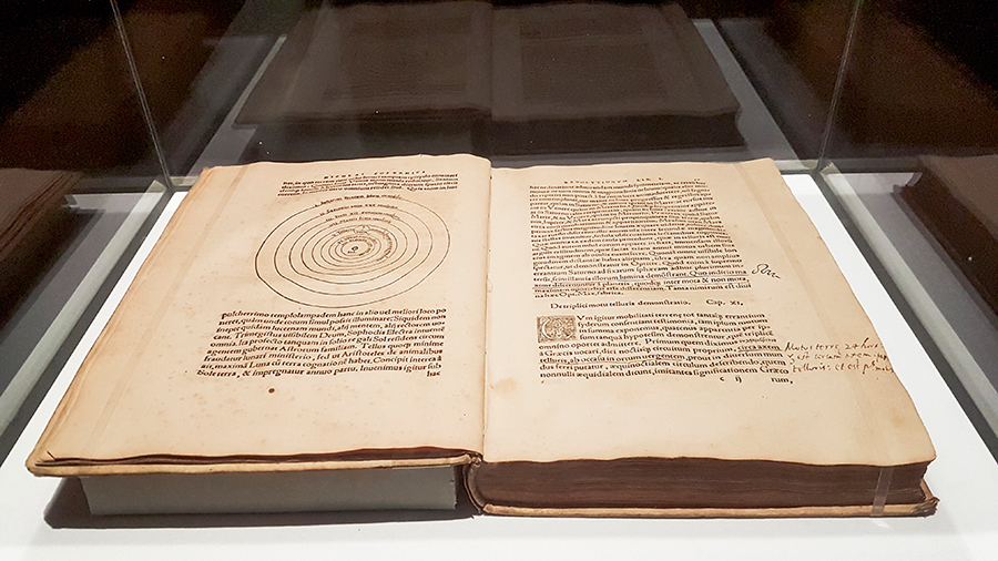 First edition book of De Revolutionibus Orbium Coelestium (On the Revolutions of the Heavenly Spheres) in 1543 by Nicolaus Copernicus at the The Universe and Art: An Artistic Voyage Through Space exhibition, ArtScience Museum Singapore.