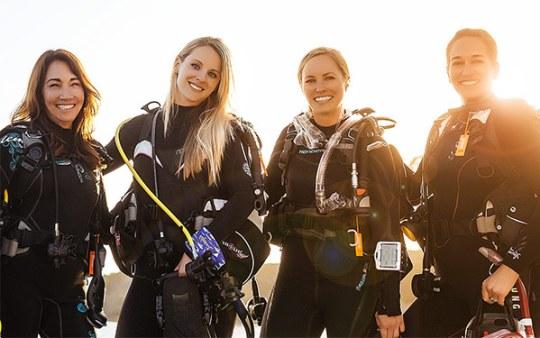 padi-women-scuba-divers-wetsuits