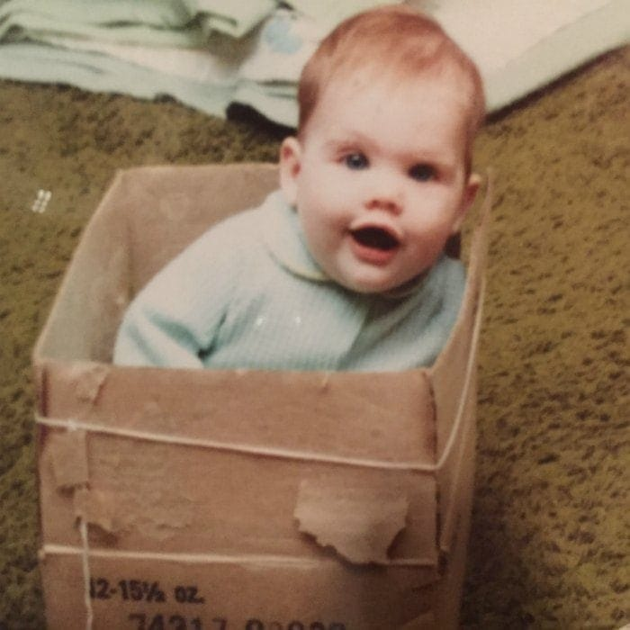 Here I am, baby Christa in her box with a string...