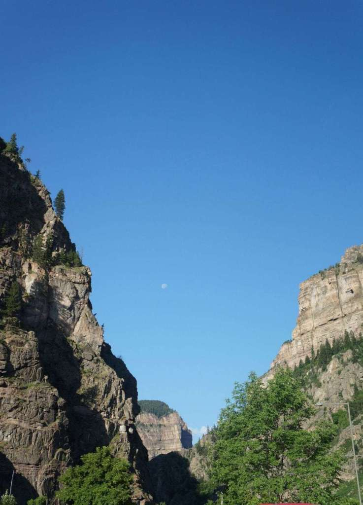 View of the Glenwood Canyon and the moon from the Hanging Lake parking lot