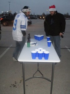 Chris and Mark playing beer pong at the cowboys game