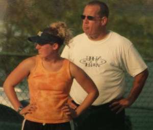 Dad and daughter as Head Coach and Assistance Coach on the Softball Field.  A modeling behaviors going on here?