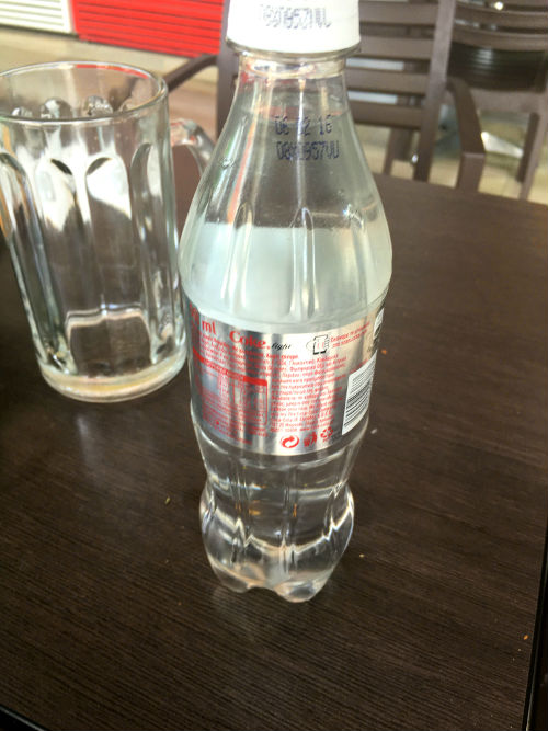 organic raki in coke bottle