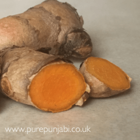 Fresh turmeric root and it's uses