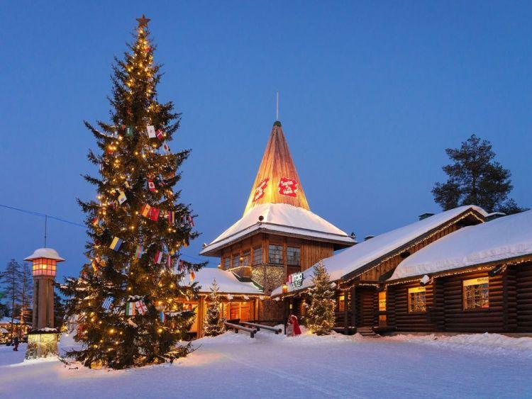 Santa Claus Village Lapland illuminated at night