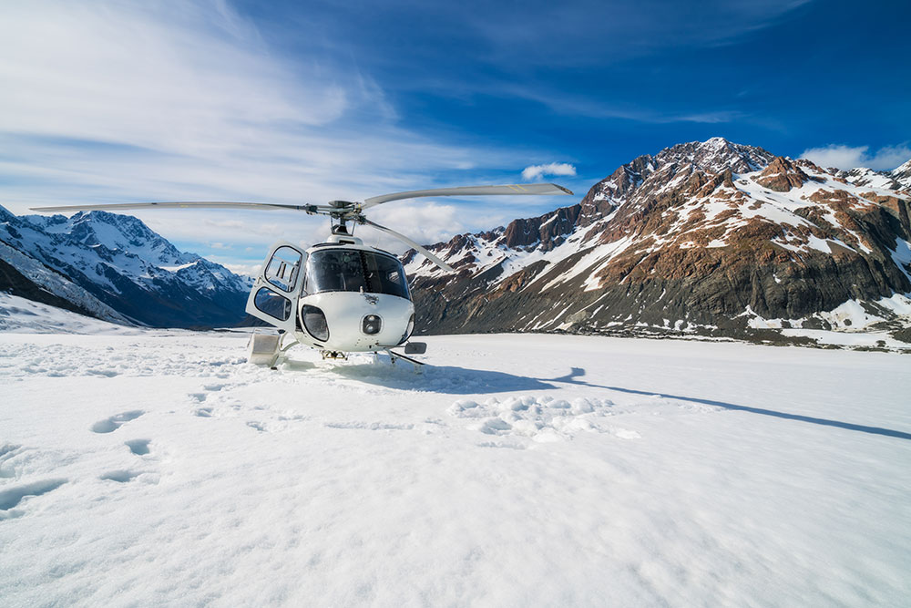 Helicopter Adventures on a New Zealand Snowy Mountain