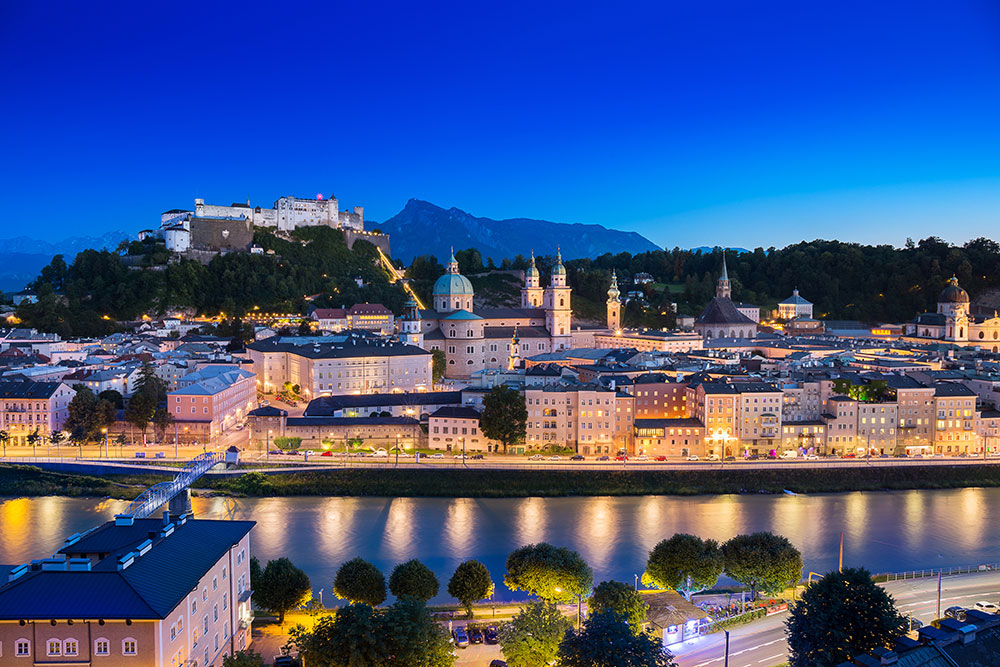 View of cityscape of Salzburg Cathedral, Fortress Hohensalzburg, and old castle in center of old town