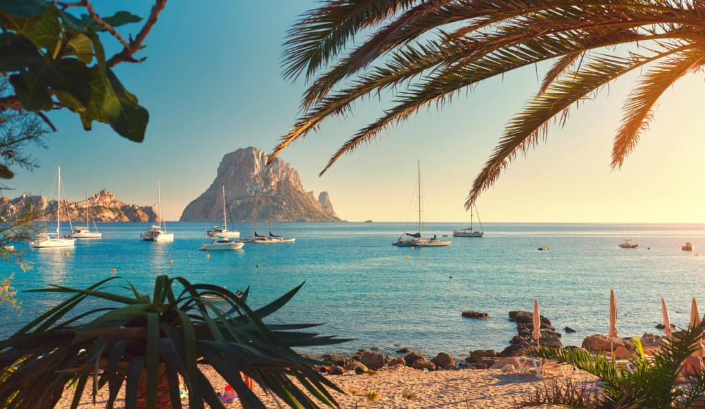 Cala d'Hort beach has a fantastic view of the mysterious island of Es Vedra. Ibiza Island, Balearic Islands. Spain