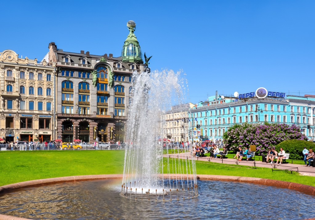 Singer (Zinger) House on Nevsky prospect and fountain on Kazan square, St. Petersburg, Russia