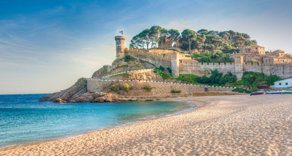 View of the fortified walls of the Vila Vella of Tossa de Mar from the beach.