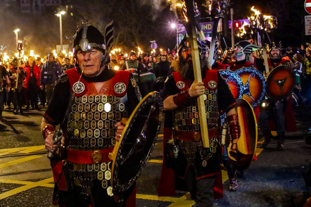 Hogmanay torchlight procession through streets to celebrate New Year's Eve in Edinburgh