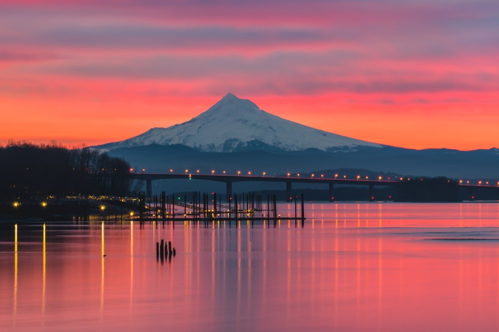 A vibrant pink sunrise over the Columbia River and Mt Hood, Portland Oregon