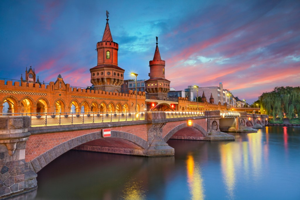 Image of Oberbaum Bridge in Berlin, during dramatic sunset.