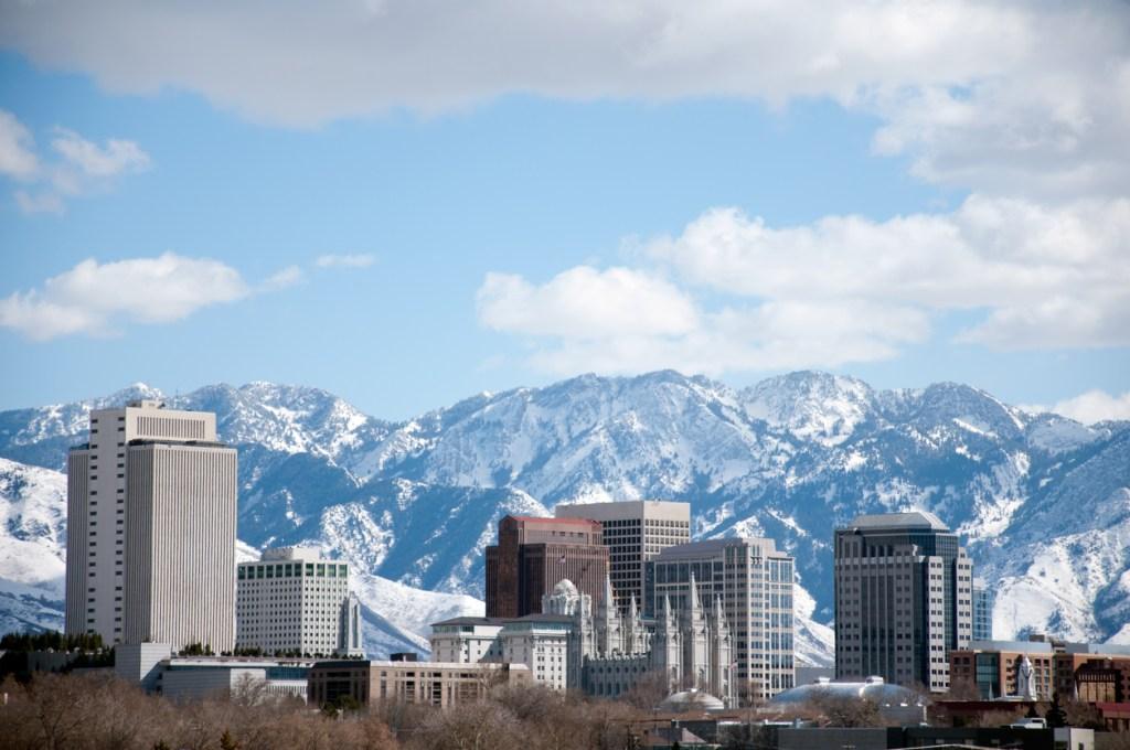 Salt Lake City Utah Winter Skyline With Snow Covered Mountains