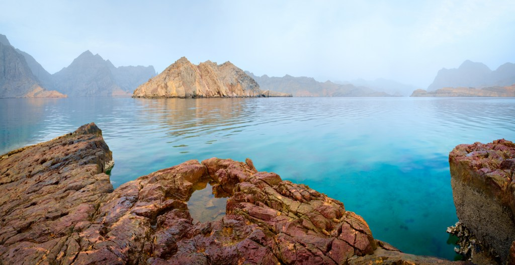 Sea tropical dawn landscape with mountains and fjords, Oman