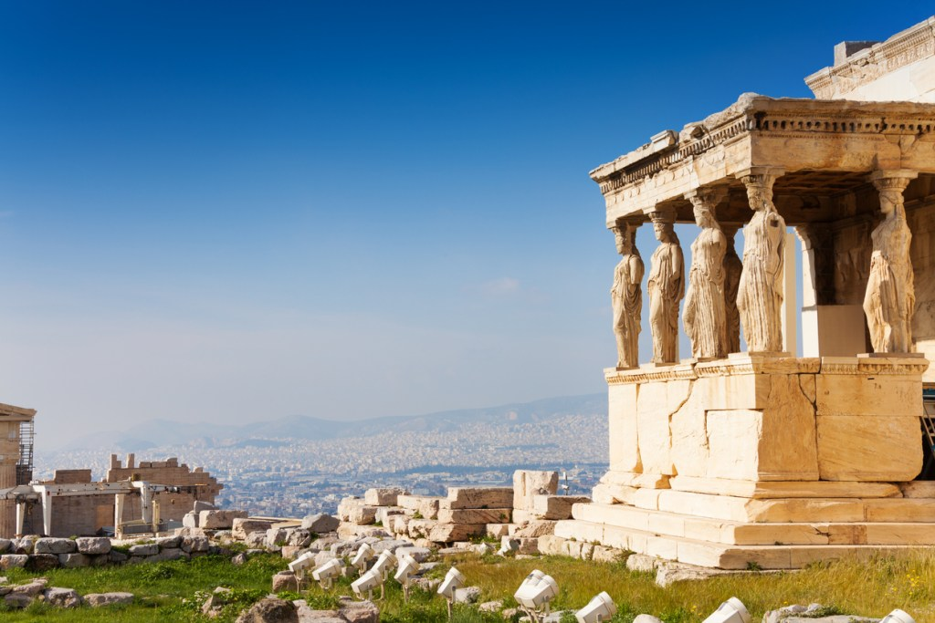 Beautiful view of Erechtheion with the panorama of Acropolis in summer in Athens, Greece