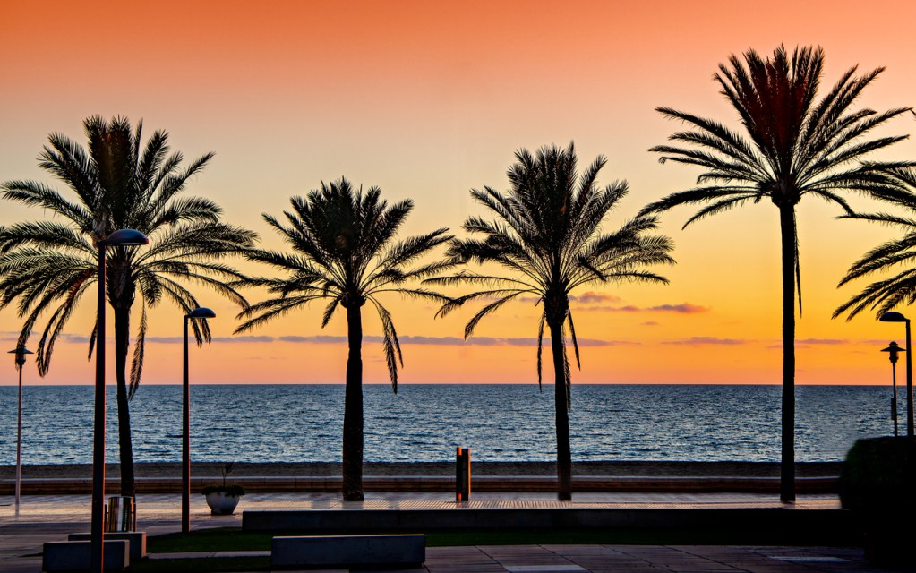 Mediterranean beach sunset in the beach of El Zapillo in Almeria, Andalusia, southern Spain.