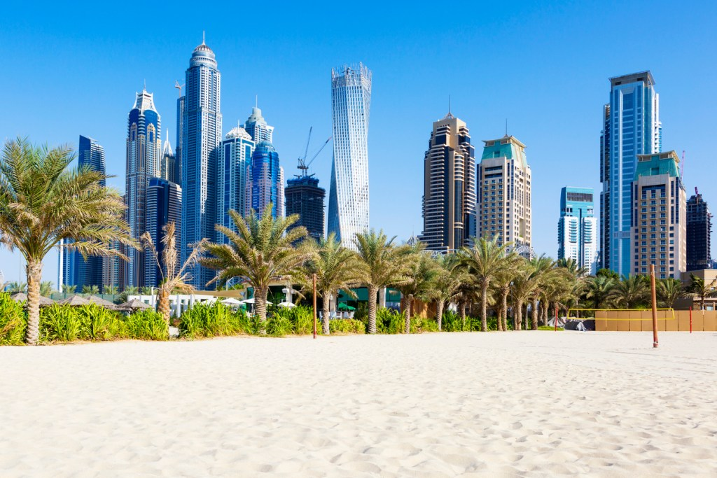 Horizontal view of skyscrapers and jumeirah beach in Dubai. UAE